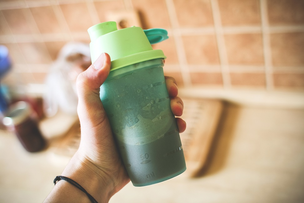man-holding-fitness-gainer-protein-shake